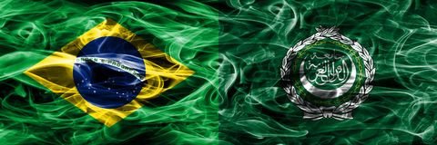Brazil vs Arab League smoke flags placed side by side.  royalty free stock photography