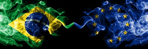 Brazil vs European Union, EU smoke flags placed side by side. Thick colored silky smoke flags of Brazilian and European Union, EU.  royalty free illustration