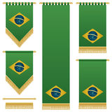 Brazil wall hangings. Green brazil wall hangings with gold tassel fringing, isolated on white Royalty Free Stock Photography