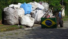 Brazil waste recycling and poverty. Recyclable trash bags to be transported by human traction vehicle Royalty Free Stock Photos