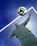 Brazil 2014 World Cup. Concept with Christ the saviour in goals and Brazuca football Stock Image