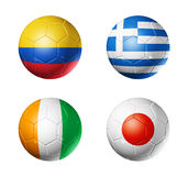 Brazil world cup 2014 group C flags on soccer ball. 3D soccer balls with group C teams flags, Football world cup Brazil 2014. isolated on white Stock Image