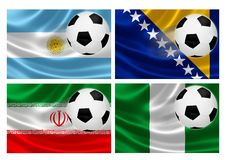 Brazil World Cup 2014 Group F. 3D flags of World Cup Brazil 2014 Group F teams, with soccer ball streaking across. Isolated on white Royalty Free Stock Photos