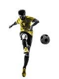 Braziliaans de jonge mens van de voetbalvoetbalster het schoppen silhouet royalty-vrije stock fotografie