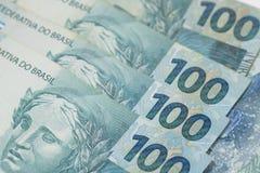 Braziliaanse geldachtergrond Rekeningen genoemd Echt Royalty-vrije Stock Afbeeldingen