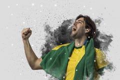 Braziliaanse voetballer die uit een ontploffing van rook komen Celebrat royalty-vrije stock foto
