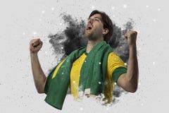 Braziliaanse voetballer die uit een ontploffing van rook komen Celebrat stock foto