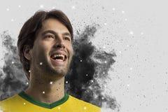 Braziliaanse voetballer die uit een ontploffing van rook komen Celebrat stock afbeelding