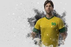 Braziliaanse voetballer die uit een ontploffing van rook komen Celebrat stock foto's