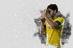 Braziliaanse voetballer die uit een ontploffing van rook komen Celebrat stock fotografie
