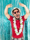 Brazilian is with arms raised and shouting. Caucasian man in red. Brazilian is very happy. In the background a bright curtain. Caucasian man in red sunglasses Stock Photos