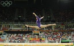 Brazilian artistic gymnast Rebeca Andrade competes on the balance beam at women`s all-around gymnastics at Rio 2016 Olympic Games. RIO DE JANEIRO, BRAZIL Stock Image