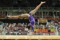 Brazilian artistic gymnast Rebeca Andrade competes on the balance beam at women`s all-around gymnastics at Rio 2016 Olympic Games. RIO DE JANEIRO, BRAZIL Stock Photos
