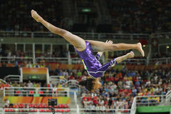 Brazilian artistic gymnast Rebeca Andrade competes on the balance beam at women`s all-around gymnastics at Rio 2016 Olympic Games. RIO DE JANEIRO, BRAZIL Royalty Free Stock Images