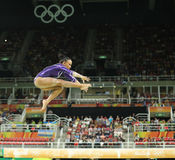 Brazilian artistic gymnast Rebeca Andrade competes on the balance beam at women`s all-around gymnastics at Rio 2016 Olympic Games. RIO DE JANEIRO, BRAZIL Royalty Free Stock Photo