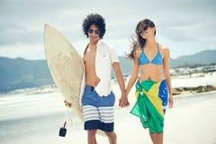 Brazilian beach couple Royalty Free Stock Photos