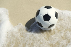 Brazilian Beach Soccer Football in the Wave Royalty Free Stock Photos