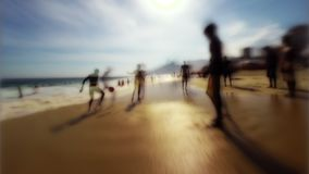Brazilian Beach Soccer Rio de Janeiro. Stylized silhouettes of people playing soccer on the beach in Rio de Janeiro, Brazil stock footage
