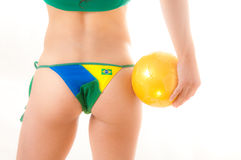 Brazilian Bikini Bottom model holding soccer ball Royalty Free Stock Photo