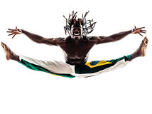 Brazilian  black man dancer dancing capoeira  silhouette. One brazilian black man dancer dancing capoeira on white background Royalty Free Stock Image