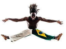 Brazilian  black man dancer dancing capoeira  silhouette. One Brazilian black man dancer dancing capoeira on white background Royalty Free Stock Photography