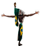 Brazilian  black man dancer dancing capoeira  silhouette. One Brazilian black man dancer dancing capoeira on white background Stock Photography