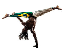 Brazilian  black man dancer dancing capoiera. One brazilian  black man dancer dancing capoiera on white background Stock Image