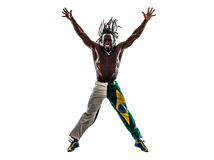 Brazilian  black man jumping arms outstretched silhouette Stock Photo