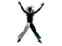 Brazilian  black man jumping arms outstretched silhouette Royalty Free Stock Photography