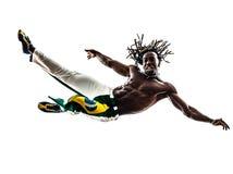 Brazilian  black man jumping dancing capoeira dancer   silhouett. One Brazilian black man jumping dancing capoeira dancer on white background Royalty Free Stock Images
