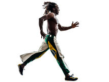 Brazilian  black man running jumping silhouette. One Brazilian black man running jumping on white background Royalty Free Stock Photos