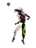 Brazilian  black man soccer player heading football silhouette Stock Images