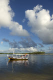Brazilian Boat Anchored in Shallow Water Royalty Free Stock Photos