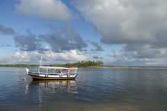 Brazilian Boat Anchored in Shallow Water Royalty Free Stock Photo