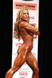 Juliana Malacarne. Brazilian bombshell Juliana Malacarne flashes superb form during her performance routine as she wins the 2012 IFBB New York Pro Physique Stock Images