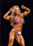 Samba Muscles. Brazilian bombshell Juliana Malacarne swings into her routine displaying her superb athletic figure on her way to garnering first place in the Royalty Free Stock Photography