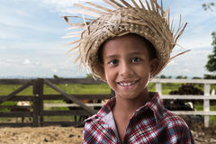Brazilian boy on caipira costume on the farm.  Royalty Free Stock Image