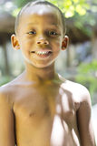 Brazilian boy. RIO DE JANEIRO, BRAZIL - DECEMBER 20, 2012: Brazilian boy smiles while waiting the issuance of land possession ceremony at the slum of Cantagalo Stock Image