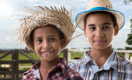 Brazilian boys on caipira costume on the farm.  Stock Images
