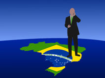 Brazilian business man on map Stock Photography