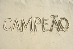 Brazilian Campeao Champion Message Handwritten in Sand Stock Images