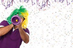 Brazilian Carnival with a horn. Brazilian guy blowing vuvuzela at Carnival time Stock Photography