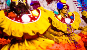 Brazilian Carnival. Parade of the Ita Lions samba school on the avenue in Ilhabela, Brazil, 02/28/2017. Artistic photo with select. Ive focus and background blur Royalty Free Stock Photography