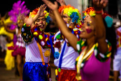 Brazilian Carnival. Parade of the Ita Lions samba school on the avenue in Ilhabela, Brazil, 02/28/2017. Artistic photo with select. Ive focus and background blur Stock Photos