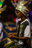 Brazilian Carnival. Parade of the Ita Lions samba school on the avenue in Ilhabela, Brazil, 02/28/2017. Artistic photo with select. Ive focus and background blur Stock Photography