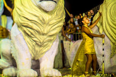 Brazilian Carnival. Parade of the Ita Lions samba school on the avenue in Ilhabela, Brazil, 02/28/2017. Artistic photo with select Stock Photo