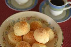 Brazilian cheese bread. A batch of brazilian cheese bread with coffee for breakfast or afternoon snack Stock Photography