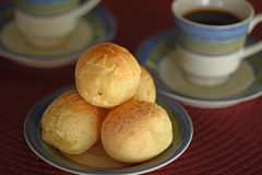 Brazilian cheese bread. A batch of brazilian cheese bread and coffee for breakfast or afternoon snack Stock Image
