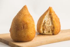 Brazilian Chicken Coxinha. Over a white background Royalty Free Stock Photos
