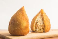 Brazilian Chicken Coxinha. Over a wooden table Stock Photo